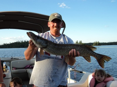 Guest with Big Northern Pike Catch