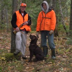 Hunters with Dog