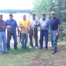 Happy group of fishermen